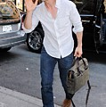 Tom Cruise Carrying A Filson Bag by Everett