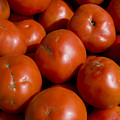 Tomatoes Sit In The Sun Awaiting Buyers by Stephen St. John
