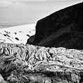 tourist couple at the end of Skaftafell glacier Vatnajokull national park in Iceland by Joe Fox