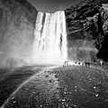 Tourists And Double Rainbow At Skogafoss Waterfall In Iceland by Joe Fox