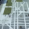Tourists Walking Along Freedom Plaza by Kenneth Garrett
