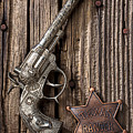 Toy Gun And Ranger Badge by Garry Gay
