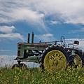 Tractor In Field by Rikk Flohr