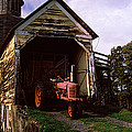 Tractor Parked Inside Of A Round Barn by Panoramic Images