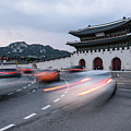 Traffic Rushing In Front Of The Gyeongbokgung Palace In Seoul  by Didier Marti