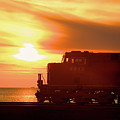 Train And Sunset by Paul Kloschinsky