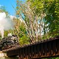 Train Approaching Bridge by Kenneth Sponsler