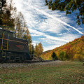 Train On The Tracks In The Mountains During Fall Season by Dan Friend