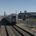 Trains Passing The Home Of The Chicago White Sox by Thomas Woolworth