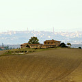 Tuscan Farm House With The City Of Siena On The Background by Nannie Van der Wal