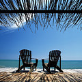 Two Chairs On Deck By Ocean Shaded By by Axiom Photographic