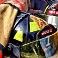 Two Fire Helmets And Fireman's Jacket by Susan Savad