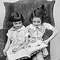 Two Girls Reading A Book, C.1920-30s by H. Armstrong Roberts/ClassicStock