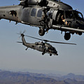 Two Hh-60 Pave Hawk Helicopters Prepare by Stocktrek Images