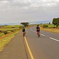 Two Men Riding Bicycle In Tanzania by Marek Poplawski