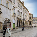 Two Nuns In Luza Square, Dubrovnik, Croatia by Global Light Photography - Nicole Leffer