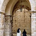 Two Nuns Leaving Luza Square, Dubrovnik, Croatia by Global Light Photography - Nicole Leffer