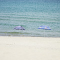 Two Parasols On Empty Beach by Newnow Photography By Vera Cepic