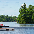Two Red Chairs On A Dock by Les Palenik