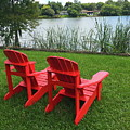 Two Red Chairs Overlooking Lake Formosa by Denise Mazzocco