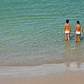 Two Teenage Girls Bathing At The Beach by Sami Sarkis