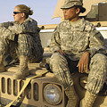 Two U.s. Army Soldiers Relax Prior by Stocktrek Images