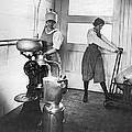 Two Women Making Butter by Underwood Archives