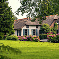 typical dutch county side of houses and gardens, Giethoorn by Ariadna De Raadt