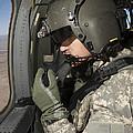 Uh-60 Black Hawk Crew Chief Looking by Terry Moore