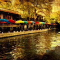 Umbrellas In The Riverwalk by Iris Greenwell