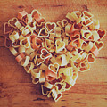 Uncooked Heart-shaped Pasta by Julia Davila-Lampe