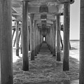Under Huntington Beach Pier by Ana V Ramirez