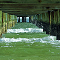 Under The Pier At Anna Marie Island by D Hackett