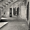 Under The Stairs At Fort Macon Black And White by Lisa Wooten