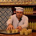 Uniformed Staff At Vefa Boza Drink Maker Carries Drinks Istanbul Turkey by Imran Ahmed