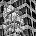 Urban Abstract - Mirrored High-rise Building In Black And White by Mitch Spence