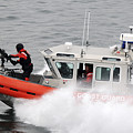 U.s. Coast Guardsmen Aboard A Security by Stocktrek Images