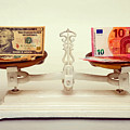 U.s. Dollar And Euro Banknotes On A Pair Of Scales In Vienna by Don Kuing
