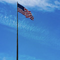 Us Flag At Liberty Island by Srinivasan Venkatarajan