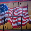 Us Flag On Side Of Freight Engine by Thomas Marchessault