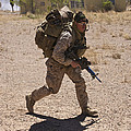 U.s. Marine Runs To The Uh-60 Black by Terry Moore