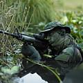U.s. Navy Seal Crosses Through A Stream by Tom Weber