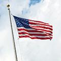 Usa Flag On Blue Sky With Clouds by Antonio Gravante