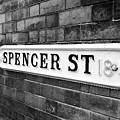 victorian metal street sign for spencer street on red brick building in the jewellery quarter Birmin by Joe Fox