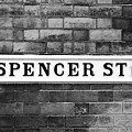 Victorian Metal Street Sign For Spencer Street On Red Brick Building In The Jewellery Quarter by Joe Fox
