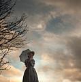Victorian Woman Alone In A Landscape In Silhouette by Lee Avison