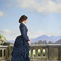 Victorian Woman In A Blue Dress Standing On The Terrace  by Lee Avison
