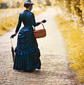 Victorian Woman With A Wicker Shopping Basket by Lee Avison