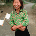 Vietnamese Girl With White Paper Flags by Silva Wischeropp
