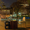View Of Chess Board In The Middle Of Busy Sidewalk At Night by PorqueNo Studios